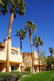 Southwestern style hotel buildings. RANCHO MIRAGE, CALIFORNIA - DEC 16, 2015 - Southwestern style hotel buildings in green oasis with Palm trees, Rancho Mirage stock photos