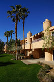 Southwestern style hotel buildings. RANCHO MIRAGE, CALIFORNIA - DEC 16, 2015 - Southwestern style hotel buildings in green oasis with Palm trees, Rancho Mirage royalty free stock photography