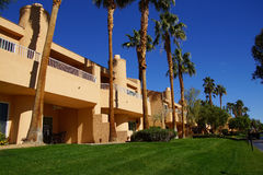 Southwestern style hotel buildings. RANCHO MIRAGE, CALIFORNIA - DEC 16, 2015 - Southwestern style hotel buildings in green oasis with Palm trees, Rancho Mirage stock images