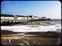 Southwold pier on a cold winter day. Rough sea around Southwold pier Royalty Free Stock Photo