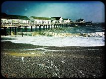 Southwold pier on a cold winter day. Rough sea around Southwold pier Stock Photo