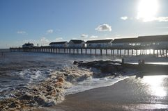 Southwold Pier, Suffolk UK, with choppy seas. On a clear winters day Stock Image