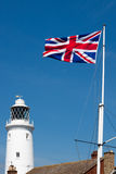 SOUTHWOLD, SUFFOLK/UK - JUNE 2 : Union jack flag flying near the. Lighthouse in Southwold Suffolk on June 2, 2010 royalty free stock photos
