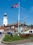 SOUTHWOLD, SUFFOLK/UK - JUNE 2 : Union jack flag flying near the. Lighthouse in Southwold Suffolk on June 2, 2010. Unidentified people stock images