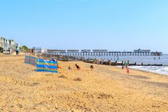 People having fun on the Southwold beach with the Southwold pier stock images
