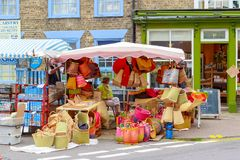 Street stall selling wicker woven baskets in the outdoor market of Southwold stock photos