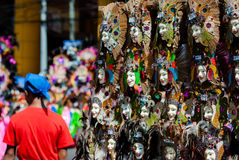 Souvenier mask displayed at the street for sale Stock Image