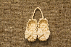 Souvenir bast shoe. Souvenir shoeson the texture of the bag from the fibers Royalty Free Stock Photo
