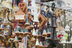 Souvenir bells at the market. Souvenir ceramic bells and toy houses at the market, local national craft of Ukraine Stock Photo