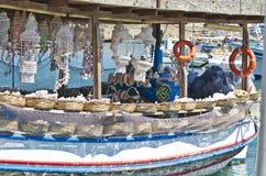 Souvenir boat in Greek harbor Stock Photography