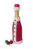 Souvenir bottle of champagne and christmas balls Royalty Free Stock Photos