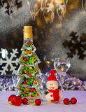 Souvenir bottle and Christmas snowman Royalty Free Stock Images