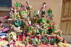 Souvenir cacti figures. At suvenir shop. State Missiones, Argentina. Colored cups for mate. Bambillya calabash sold as souvenirs for turists Indian national Stock Image