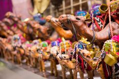 Souvenir camels sold at Middle East street market stock photos
