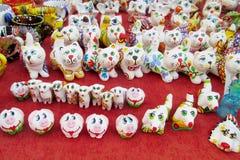 Souvenir cat figurines Stock Images