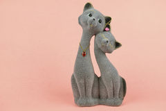 Souvenir cats in love on a pink background Royalty Free Stock Image