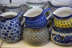 Souvenir ceramic jugs painted in blue color. Small souvenir ceramic jugs painted in blue color Royalty Free Stock Photography