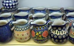 Souvenir ceramic jugs painted in blue color. Small souvenir ceramic jugs painted in blue color Stock Photo
