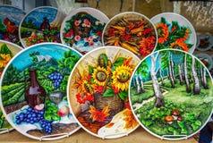 Souvenir ceramic plate with still lifes. 3D design.  royalty free stock image