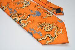 Souvenir from China. Tie with dragons - souvenir from China Stock Photography