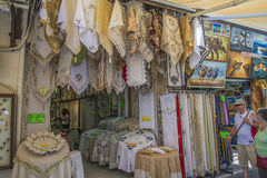 Souvenir, clothing, leather and art business in the old town Royalty Free Stock Image