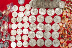 Souvenir coins for sale at asian market. Laos Royalty Free Stock Photo