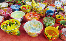 Souvenir colorful plates sold on the street. In Andreevsky spusk in Kiev, Ukraine. Modern art, abstract and realistic paintings and art crafts, traditional arts Stock Photo