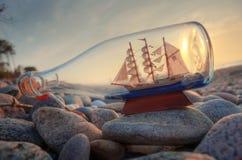 Souvenir conceptual image. Ship in a bottle Stock Images