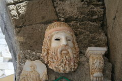 Souvenir depicting a Greek mask. Souvenir depicting Poseidon mask. Poseidon is the god of the sea and earthquakes in Greek mythology and in Greek religion. Son Stock Photos