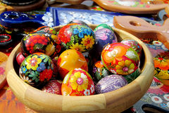 Souvenir eggs. Souvenirs wooden eggs painted with colorful flowers and birds sold on the street in Andreevsky spusk in Kiev, Ukraine. Traditional arts and vector illustration