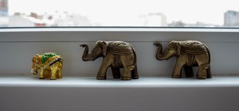 A three souvenir elephant on a white background stock photography