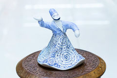 Souvenir figure of a dancing Turkish men in traditional white dr Stock Photography