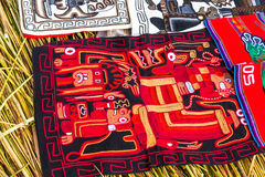 Souvenir on Floating islands Titicaca lake, Peru,South America. Street shop with colorful blanket, scarf, cloth, ponchos,ornaments Stock Image