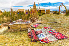 Souvenir on Floating islands Titicaca lake, Peru,South America. Street shop with colorful blanket, scarf, cloth, ponchos,ornaments Royalty Free Stock Photos