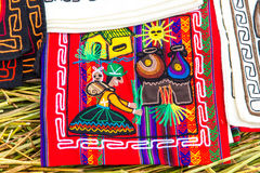 Souvenir on Floating islands Titicaca lake, Peru,South America. Street shop with colorful blanket, scarf, cloth, ponchos,ornaments Royalty Free Stock Photography