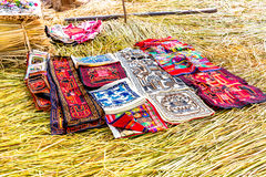 Souvenir on Floating islands Titicaca lake, Peru,South America. Street shop with colorful blanket, scarf, cloth, ponchos Stock Photos