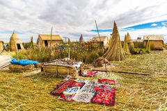 Souvenir on Floating islands Titicaca lake, Peru,South America. Street shop with colorful blanket, scarf, cloth, ponchos Stock Image
