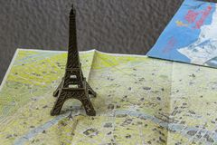 Souvenir in the form of the Eiffel Tower on the map of Paris. Booklets. Souvenirs and maps Royalty Free Stock Image