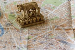 Souvenir in the form of a feeding she-wolf - a symbol of Rome. Souvenirs and maps Stock Photography