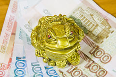 A souvenir is a frog and Russian money Royalty Free Stock Photography