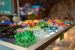 Souvenir glass beads of different colors lie on the counter. Concept of street trading the trinkets, cheap fakes. Souvenir glass beads of different colors lie royalty free stock image