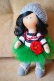 Souvenir handmade doll brunette in a lush green skirt Stock Images