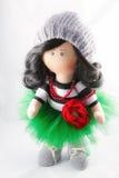 Souvenir handmade doll brunette in a lush green skirt Royalty Free Stock Images