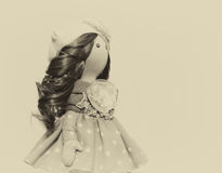 Souvenir handmade doll with natural hair Royalty Free Stock Image
