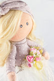 Souvenir handmade doll with natural hair Stock Images