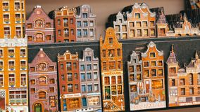 Souvenir Holland national houses in Amsterdam with narrow walls and windows with shutters. Souvenir Holland national houses in Amsterdam with narrow walls and stock video footage