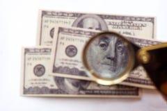 Souvenir hundred-dollar bills. Through the prism stock images