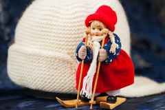 Souvenir little cross country skier , knitted hat Stock Photos