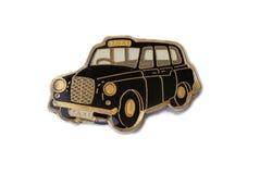 The souvenir magnet - a London cab Stock Photo