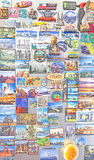 Souvenir magnets from all over the world on refrigerator. Royalty Free Stock Photography